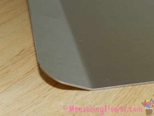 """Each sheet is solidly constructed with stainless steel. One of the short ends bends up a bit to provide a """"handle"""" to grip it by when inserting it into or pulling it out of the oven."""