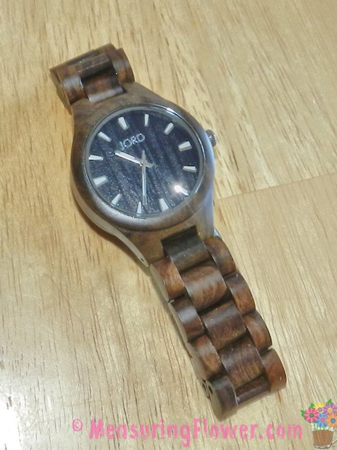 This watch is gorgeous. It has a beautiful, black wood grain face, a scratch-proof glass face cover, and a wooden wrist band.