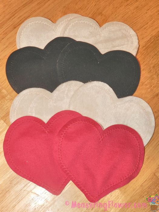 The 4 pairs of regular Bamboobies nursing pads (2 pairs are white, one pair black, and one pair pink) are absolutely adorable. They are constructed with super soft organic cotton and bamboo rayon velour with interior layers of hemp and organic cotton.