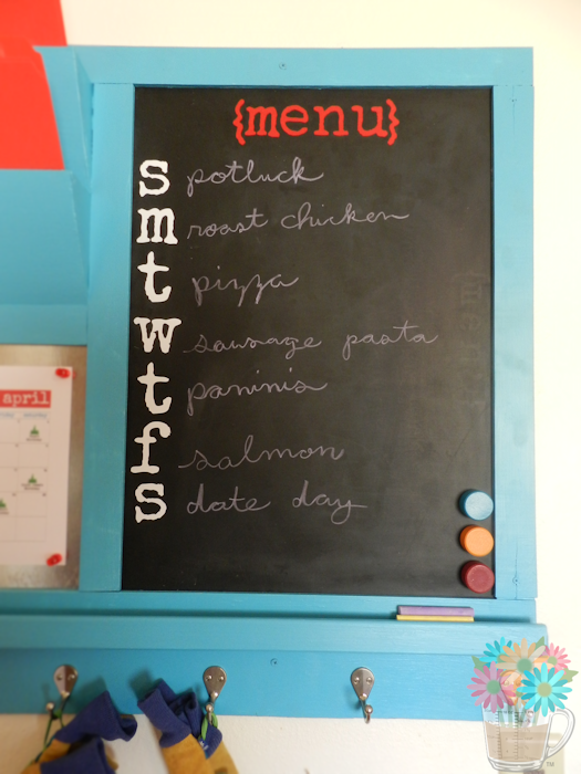 "One of my favorite elements of the command center is the chalkboard menu. We had this chalkboard that we had used for a menu before, so, when we made this command center, we removed the frame and glued to the back of the command center. The ""{menu}"" and weekday lettering I made with vinyl using my Silhouette machine."
